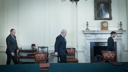 Prime Minister Boris Johnson (centre) arrives with Cabinet secretary, Mark Sedwill (left) and Chance