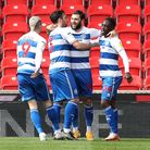 QPR's Charlie Austin (centre) celebrates scoring their first goal against Stoke in the Championship at the bet365 Stadium