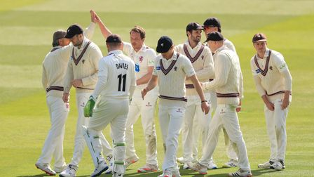 Somerset's Josh Davey (facing) celebrates taking a wicket against Middlesex
