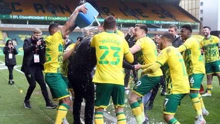 Norwich Head Coach Daniel Farke gets a bucket of ice thrown over him by Onel Hernandez of Norwich at
