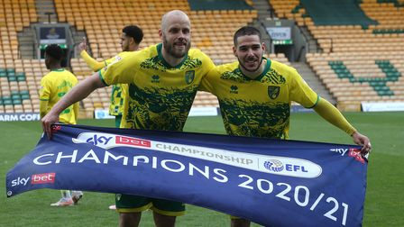 Teemu Pukki of Norwich and Emiliano Buendia of Norwich at the end of the Sky Bet Championship match