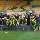 The Norwich players celebrate winning there title at the end of the Sky Bet Championship match at Ca