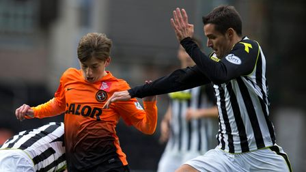 Dundee United's Ryan Gauld is stopped by St Mirren's Lee Mair during the Scottish Premier League mat