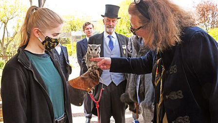Princess Katrina with one of the owls and staff at the Raptor Foundation.