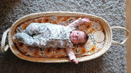 Baby in moses basket