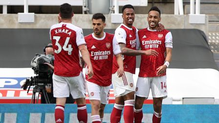 Arsenal's Pierre-Emerick Aubameyang (right) celebrates scoring their second goal against Newcastle at St James' Park