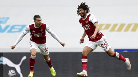 Arsenal's Mohamed Elneny (right) celebrates scoring their first goal in the Premier League match against Newcastle