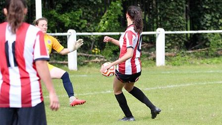 Larissa Vieira scores Clapton's fourth. Photo by Nick Davidson