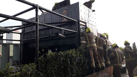 Firefighters tackle a roof terrace fire at a hotel in International Way, Stratford.