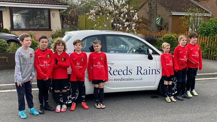 Clevedon United under-eights in new kit sponsored by Reeds Rains