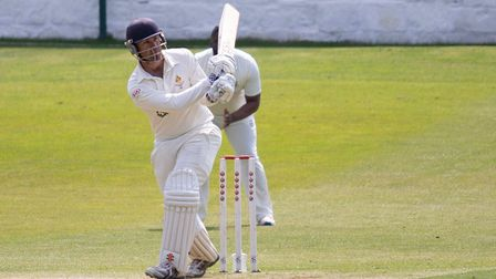Harry Ellison hits a boundary for Clevedon at Bath