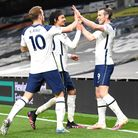 Tottenham Hotspur's Gareth Bale (right) scores their side's second goal of the game with team-mates