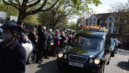 People lining Bethell Avenue applaud the funeral cortege of Kevin Jenkins OBE who is the founder of