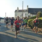 Runners set off on their half marathon around the Sid Valley