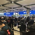 Dense crowds in the customs hall at Heathrow