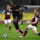 West Ham United's Michail Antonio (left) and Burnley's Ben Mee (right) battle for the ball during th