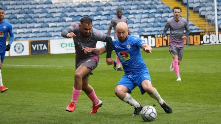 Wealdstone's Michael Phillips in action against Stockport County