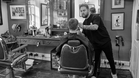 Truman's barber Ross Mathieson pictured in the Elm Hill salon