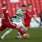 Celtic's Ryan Christie (centre) in action with Aberdeen's Florian Kamberi (left) during the Scottish