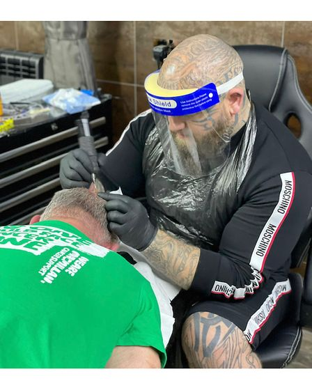 Paul Stansby from Lucky 13 Tattoo Studio in Ipswich at work on Mark Flewitt's tattoo