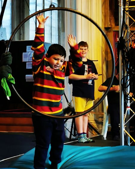 Playing with hoops at a Twinkle's circus session in Norwich