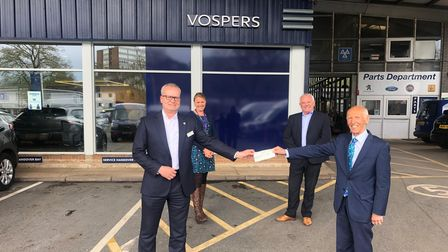 Peter Vosper presents the Vospers donation toMark Hawkins, with Alison Upton and Jim Parker looking on