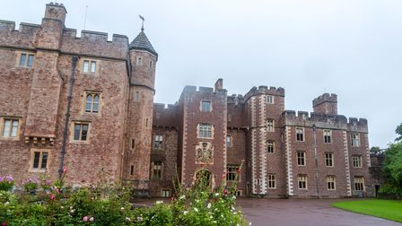Dunster Castle is a former motte and bailey castle, now a country house, in the village of Dunster,