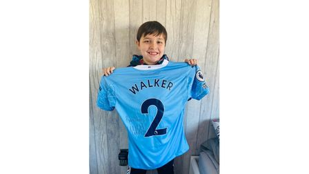 Kai Leatherbywith the signed Kyle Walker Manchester City shirt.