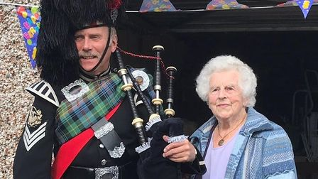 Adelaide 'Scottie' Mobbs pictured with a piper on her 95th birthday in September 2019