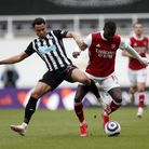 Newcastle United's Jacob Murphy (left) and Arsenal's Nicolas Pepe battle for the ball during the Pre