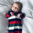 baby in stripey outfit