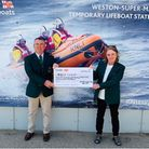 Weston Golf Club's Andy Balcombe and Alison Whitewood with their cheque for the RNLI