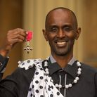 Eric Eugene Murangwa with his MBE medal, awarded by the Prince of Wales, following an investiture ce