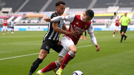 Newcastle United's Jacob Murphy (left) and Arsenal's Gabriel Martinelli battle for the ball during t