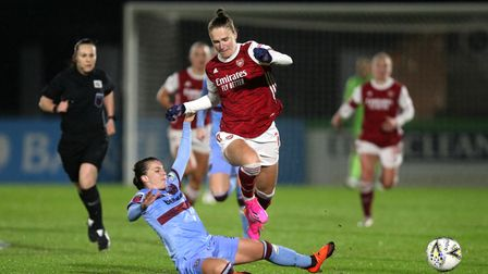 Arsenal's Vivianne Miedema (right) and West Ham United's Cecilie Redisch battle for the ball during