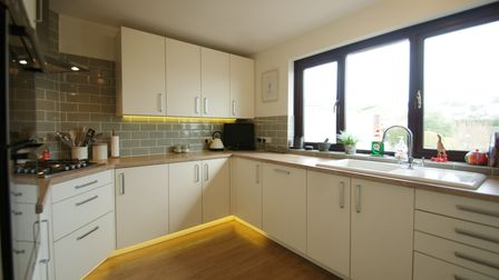 Themodern, fitted kitchen openson to a sun terrace