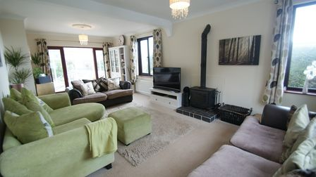 The sitting room features asolid fuel burner on tiled hearth