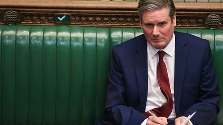 Labour leader, Sir Keir Starmer, listening to Prime Minister Boris Johnson in the House of Commons.