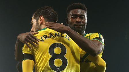 Alex Tettey congratulates Mario Vrancic on City's opening goal against Tottenham Pictures: Paul Ches