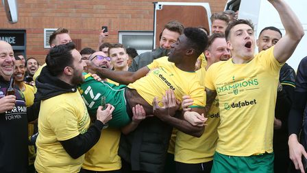 Norwich City team mates and backroom staff carry Alex Tettey during the title celebrations