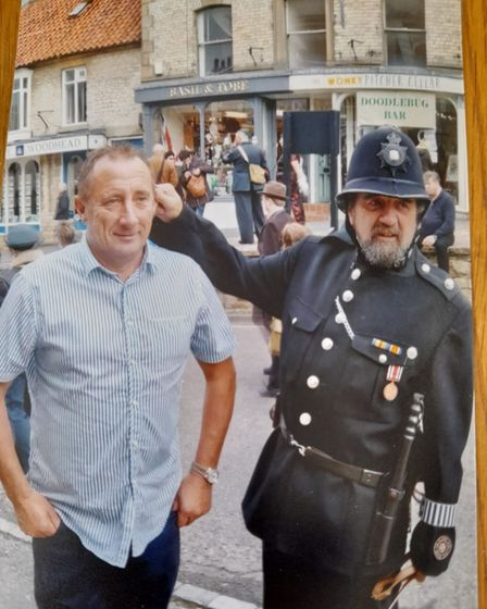 Howard Shepherdson and a man wearing a vintage Police costume.