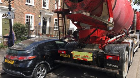 A large cement mixer damages a vehicle in Church Row on April 27