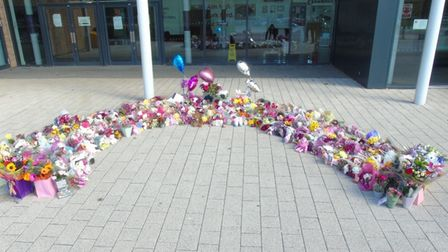 Floral tributes have been laid outside Marriotts School, Stevenage, after the passing of their Year 7 student Julia Blackham