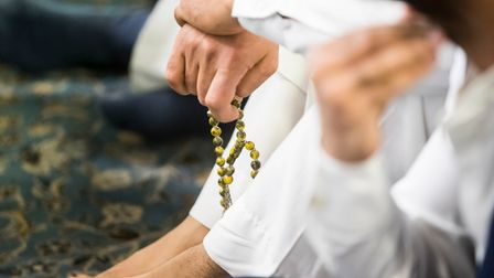 A worshipper holds pray beads ahead of the Eid prayer, which marks the end of Ramadan and the start