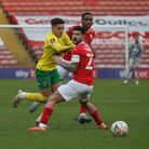 Max Aarons of Norwich, Victor Adeboyejo of Barnsley and Alex Mowatt of Barnsley in action during the
