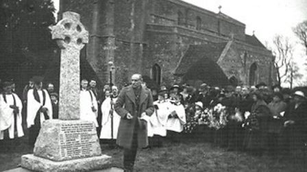The unveiling of the Great Paxton war memorial in 1921.