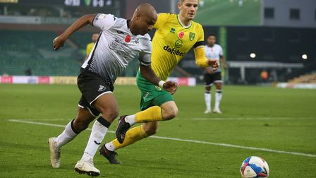 Jacob Sorensen of Norwich and Andre Ayew of Swansea City in action during the Sky Bet Championship m