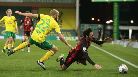 Adam Smith of Bournemouth is fouled by Teemu Pukki of Norwich during the Sky Bet Championship match