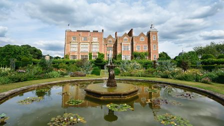 Fountain and stately home from The West Garden at Hatfield House