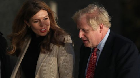Prime Minister Boris Johnson and his girlfriend Carrie Symonds arrive in Downing Street after the Co
